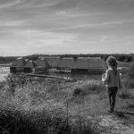 Photograph of a girl looking at the Visitor Village at Brockholes nature reserve near Preston