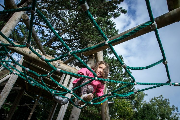 Girl on the adventure playground at Happy Mount Park in Morecambe, Lancashire