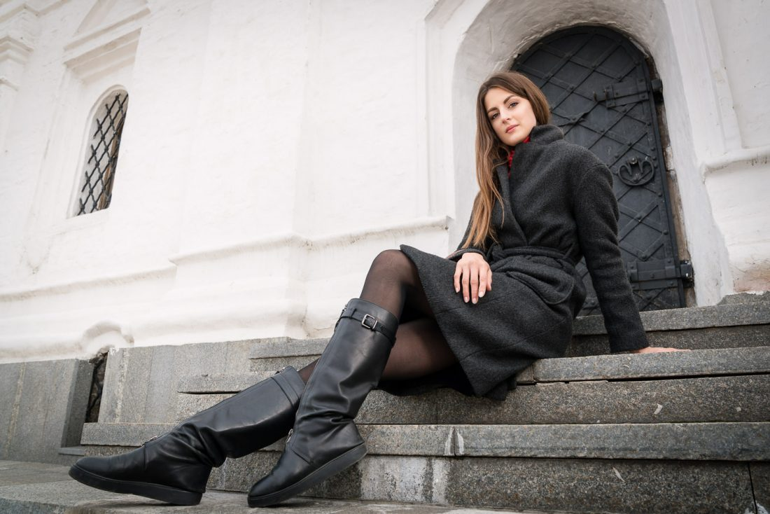 Model sitting on the steps of the refectory at St Michael's Golden-Domed Monastery in Kiev, Ukraine