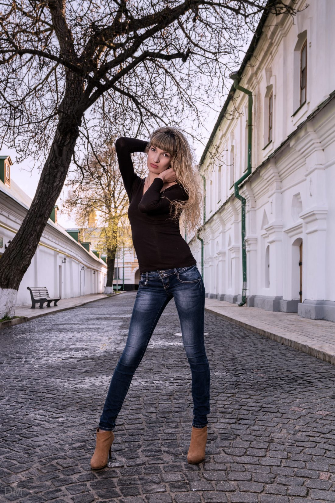 Photo of a female model stood in the middle of a road at Pechersk Lavra monastery in Kiev, Ukraine