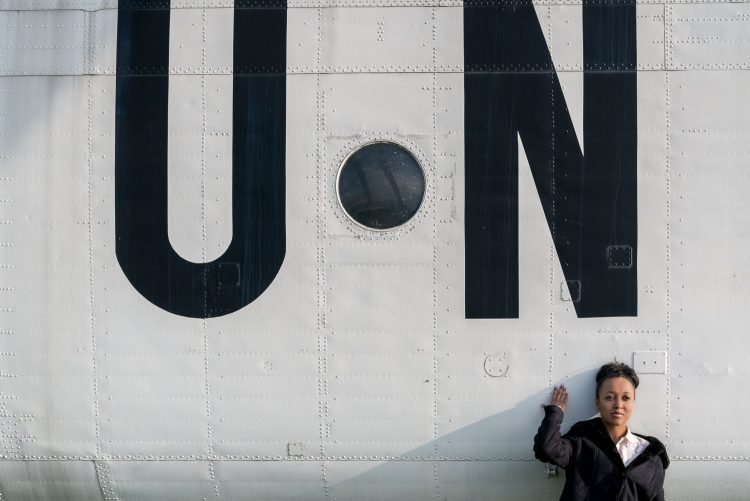 Girl stood next to a United Nations helicopter at the State Aviation Museum in Kiev, Ukraine