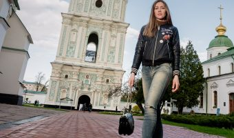 Ukrainian model stood in front of the bell tower at St Sophia's Cathedral In Kiev, Ukraine