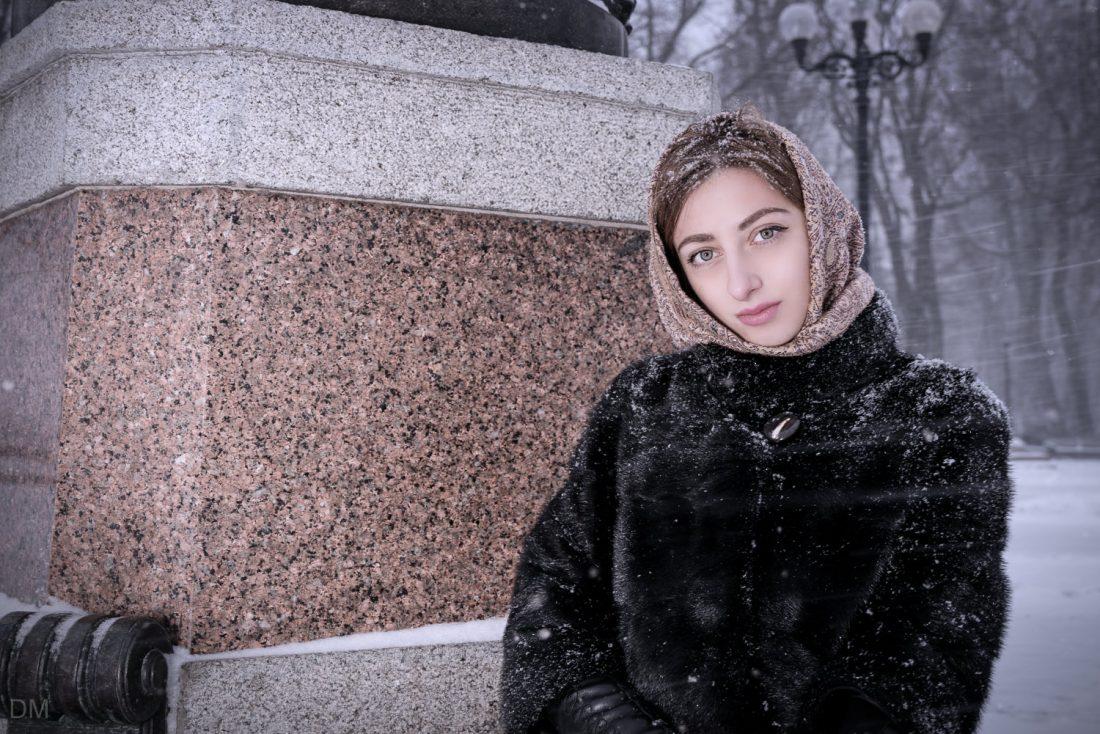 Beautiful Ukrainian girl in Mariinsky Park in the snow in Kiev, Ukraine