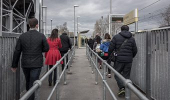 Manchester United fans walking to the platform at Old Trafford Metrolink Station