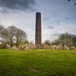 Stone cycle sculpture at Burrs Country Park in Bury, Greater Manchester