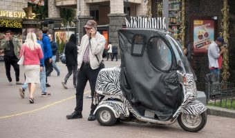 Man with a zebra styled mobility scooter in Kiev.