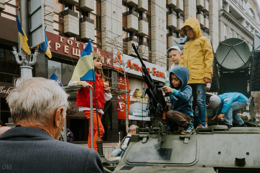 Children sitting on a Ukrainian army tank in Kiev city centre