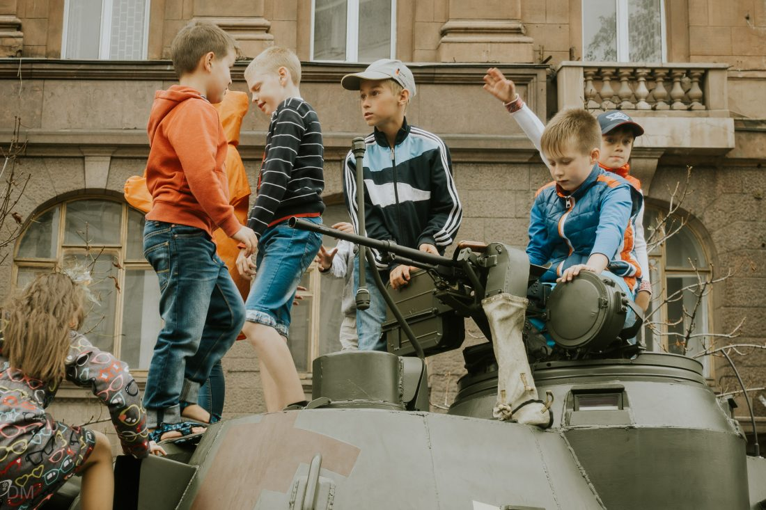 Ukrainian children playing on a tank in Kiev city centre
