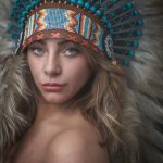 Photograph of a girl in a Native American headdress