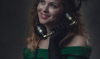 Beautiful model calling on an antique telephone.