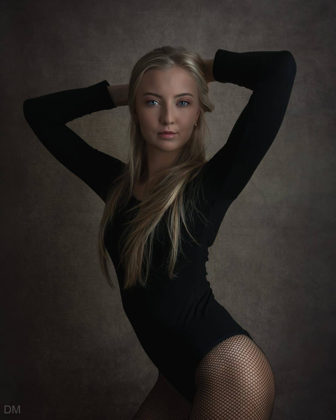Photograph of a beautiful female model in a bodysuit.
