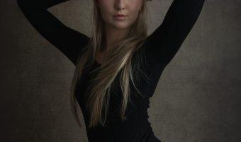 Photograph of a beautiful female model in a bodysuit.