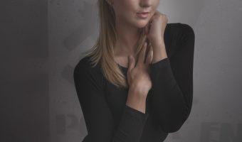 Girl in a black bodysuit