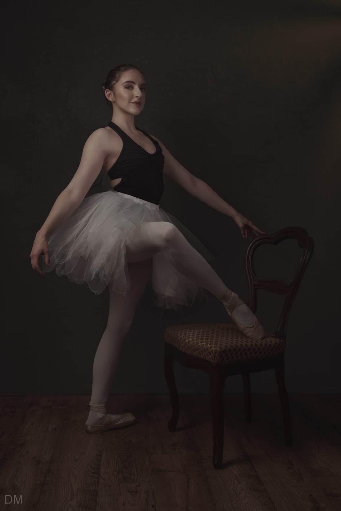 Photograph of a female ballerina wearing a tutu