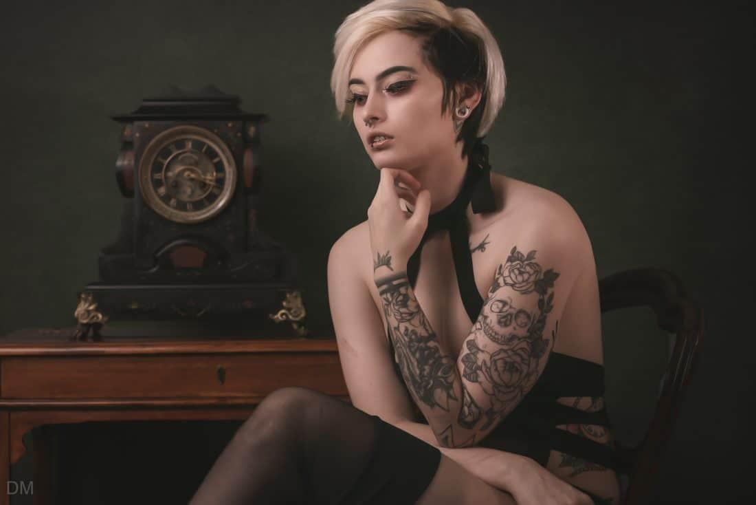 Tattooed model sat on a chair