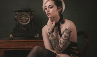Tattooed model sat on a chair